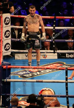 Sam Eggington celebrates after  knocking  out Paulie Malignaggi    with   at The O2 Arena , Peninsula Square  , London  on 4th March  2017