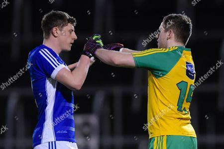 Cavan vs Donegal. Cavans Fergal Reilly and Darach OÕConnor of Donegal