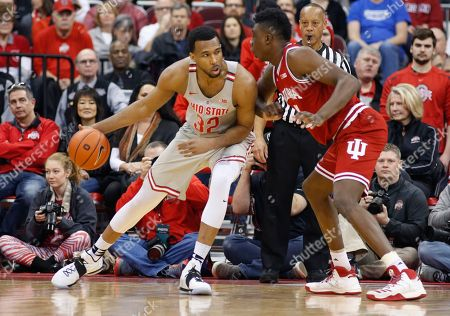 Trevor Thompson, Thomas Bryant Ohio State's Trevor Thompson, left, posts up against Indiana's Thomas Bryant during the first half of an NCAA college basketball game, in Columbus, Ohio