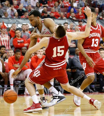 Stock Image of Trevor Thompson, Zach McRoberts Ohio State's Trevor Thompson, left, is fouled by Indiana's Zach McRoberts during the second half of an NCAA college basketball game, in Columbus, Ohio. Indiana beat Ohio State 96-92