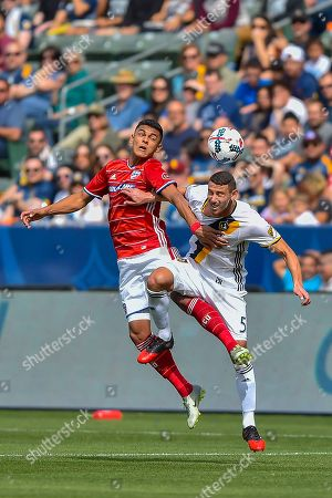 Cristian Colman, Daniel Steres FC Dallas forward Cristian Colman, left, of Paraguay, and Los Angeles Galaxy defender Daniel Steres (5) fight for a header during an MLS soccer match, in Carson, Calif