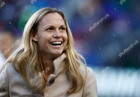 Former United States women's soccer player Christie Rampone reacts during a ceremony honoring her prior to a SheBelieves Cup women's soccer match between the United States and England, in Harrison, N.J