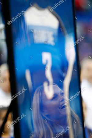 Former United States women's soccer player Christie Rampone is reflected on a frame with her jersey during a ceremony honoring her prior to a SheBelieves Cup women's soccer match between the United States and England, in Harrison, N.J