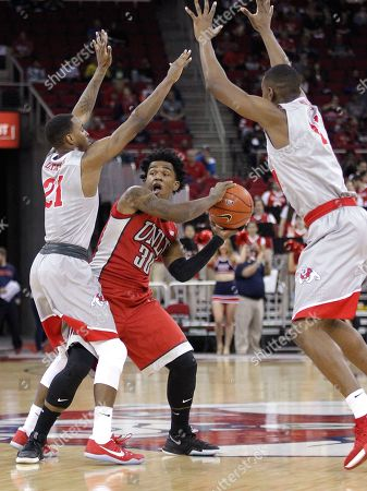 Jovan Mooring, Deshon Taylo, Paul Watson UNLV's Jovan Mooring, center, is trapped by Fresno State's Deshon Taylor and Paul Watson in the first half of an NCAA college basketball game in Fresno, Calif
