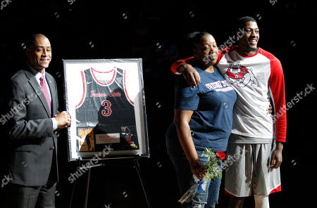 Fresno State's Paul Watson, right, is honored by coach Roney Terry, left, and his mom, Rayna, on senior night against UNLV in the first half of an NCAA college basketball game against UNLV in Fresno, Calif