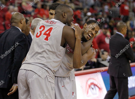 Paul Watson, Terrell Carter II Fresno State's Paul Watson gets a hug from Terrell Carter II after leaving an NCAA college basketball game against UNLV in the second half in Fresno, Calif