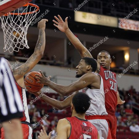 Christian Jones, Paul Watson UNLV's Christian Jones tries to stop Fresno State's Paul Watson in the second half of an NCAA college basketball game in Fresno, Calif