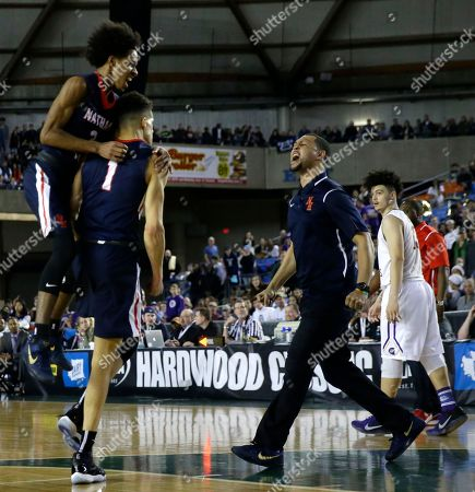 Michael Porter Jr., Brandon Roy Nathan Hale head coach Brandon Roy, center, celebrates as P.J. Fuller, left, jumps on Michael Porter Jr. (1) after Porter dunked the ball late in the second half of the Washington state boys' 3A high school basketball championship against Garfield, in Tacoma, Wash