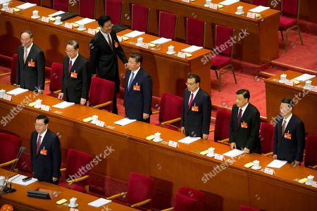 Wang Qishan, Yu Zhengsheng, Xi Jinping, Li Keqiang, Liu Yunshan, Zhang Gaoli, Zhang Dejiang Members of the Politburo Standing Committee, from left, Wang Qishan, Yu Zhengsheng, President Xi Jinping, Premier Li Keqiang, Liu Yunshan, Zhang Gaoli, and Zhang Dejiang, in front row, stand during the start of the opening session of China's annual National People's Congress in Beijing's Great Hall of the People, . China's top leadership as well as thousands of delegates from around the country are gathered at the Chinese capital for the annual legislature meetings