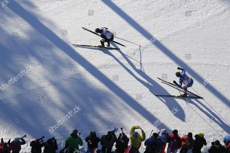 Switzerland's Dario Cologna (L) and Russia's Andrey Melnichenko in action during the Men's 50 km mass start competition at the 2017 Nordic Skiing World Championships in Lahti, Finland, 05 March 2017.
