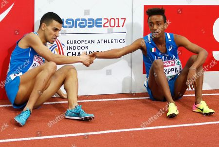Italy's Marouan Razine, left, and Italy's Yemaneberhan Crippa shake hands after the men's 3000-meter final during the European Athletics Indoor Championships in Belgrade, Serbia