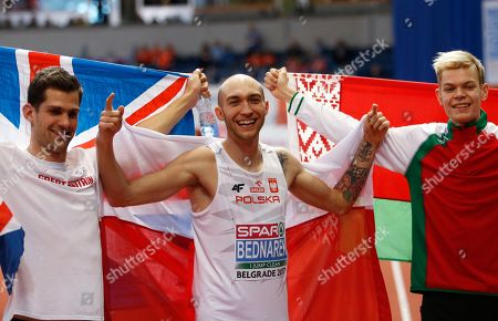 Poland's gold medal winner Sylwester Bednarek, center, celebrates with Britain's silver medal winner Robbie Grabarz, left, and Belarus' bronze medal winner Pavel Seliverstau after the men's high jump final during the European Athletics Indoor Championships in Belgrade, Serbia