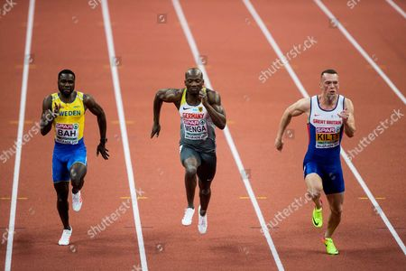 Stock Image of Sulayman Bah of Sweden, Aleixo Platini Menga of Germany, Richard Kilty of Great Britain compete in the 60m Men heats