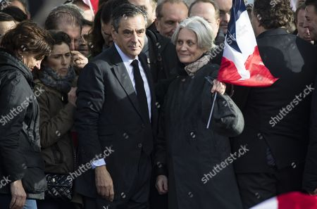 'Les Republicains' party candidate for the 2017 French presidential elections, Francois Fillon (L) flanked by his wife Penelope (R) acknowledge cheers from the crowd after his speech during a meeting organized to support him on the Place du Trocadero in Paris, France, 05 March 2017. For the past few days, the candidate has seen most of his supporters leaving as he is under justice scrutiny. France holds the first round of the 2017 presidential elections on 23 April 2017.