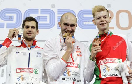 Gold medalist Silwester Bednarek (C) of Poland, bronze medalist Pavel Seliverstau (R) of Belarus and silver medalist Robbie Grabarz (L) of Great Britain pose during the award ceremony of the Men's High Jump competition at the European Athletics Indoor Championships in Belgrade, Serbia, 05 March 2017.