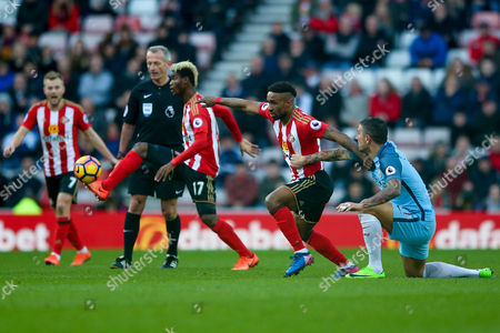 Sunderland forward Jermain Defoe (18) tries to get away from Manchester City defender Aleksander Kolarov (11)   during the Premier League match between Sunderland and Manchester City at the Stadium Of Light, Sunderland