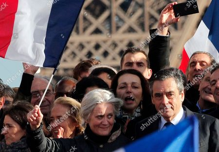 """French conservative presidential candidate Francois Fillon and his wife Penelope appear during a rally in Paris, . Fillon is urging his supporters not to """"give up the fight"""" for the presidency despite corruption allegations dogging him"""
