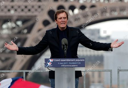 """Stock Photo of Francois Fillon's special advisor Jerome Chartier delivers a speech before French conservative presidential candidate Francois Fillon arrives for a rally in Paris, . Fillon is urging his supporters not to """"give up the fight"""" for the presidency despite corruption allegations dogging him"""