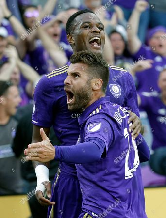 Cyle Larin, Antonio Nocerino Orlando City's Cyle Larin, back, celebrates after scoring a goal against New York City FC with teammate Antonio Nocerino (23) during the first half of an MLS soccer game, in Orlando, Fla