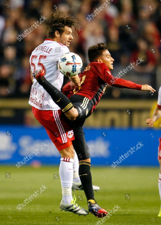 Yamil Asad, Damien Perrinelle Atlanta United midfielder Yamil Asad (11) battles for the ball against New York Red Bulls defender Damien Perrinelle (55) in the first half of an MLS soccer game, in Atlanta