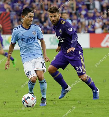 Maximiliano Moralez, Antonio Nocerino New York City FC's Maximiliano Moralez (10) looks to pass the ball to a teammate as he is defended by Orlando City's Antonio Nocerino (23) during the first half of an MLS soccer game, in Orlando, Fla
