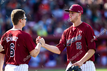 Gamecocks pitcher Adam Hill (15) shakes hands with pitcher Clarke Schmidt (6) as he leaves the game in sixth inning of the NCAA Baseball matchup at Founders Park in Columbia, SC