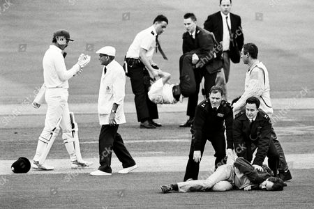 Anti-apartheid Protesters Are Restrained by Police After Seven Men Stormed the Square in an Attempt at Disruption After the First Ball Was Bowled by the West Indian Joel Garner This Was the First Visit to Lords by A Senior South African Side For 27 Years the Umpire is Dickie Bird Uk