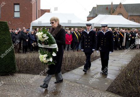 British Ambassador to Belgium Alison Rose, left, prepares to lay a wreath during a commemoration service for the the victims of the Herald of Free Enterprise in Zeebrugge, Belgium on . Thirty years have passed since the ferry Herald of Free Enterprise capsized with the loss of 193 lives shortly after setting out to Dover from the Belgian port of Zeebrugge