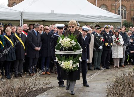 British Ambassador to Belgium Alison Rose, center, prepares to lay a wreath during a commemoration service for the the victims of the Herald of Free Enterprise in Zeebrugge, Belgium on . Thirty years have passed since the ferry Herald of Free Enterprise capsized with the loss of 193 lives shortly after setting out to Dover from the Belgian port of Zeebrugge