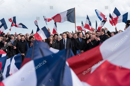 French presidential canditdate Francois Fillon (C) appears with his British born wife Penelope as he speaks to supporters at a rally in Paris.