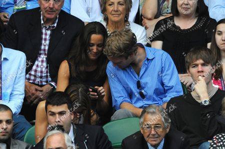 Pippa Middleton Shows A Message On Her Mobile Phone to George Percy United Kingdom London