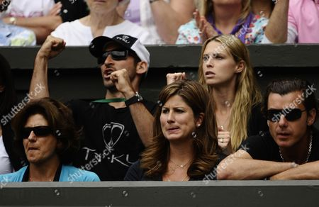 Mirka Vavrinec Wife of Roger Federer Looks On Nervously During Her Husbands Straight Sets Victory As Sara Foster (back Row Second From the Left) Girlfriend of Tommy Haas of Germany Sits Behind Giving Him Her Full Support United Kingdom London