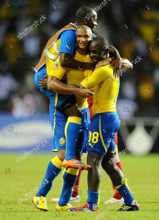 Gabon's Daniel Cousin (c) is Mobbed by Teammates After Scoring His Sides Second Goal