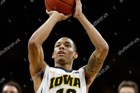 Iowa guard Christian Williams shoots a free throw during the second half of an NCAA college basketball game against Penn State, in Iowa City, Iowa. Iowa won 90-79