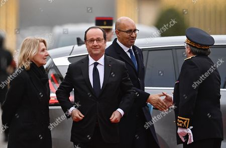 French President Francois Hollande (C), French junior minister for European Affairs Harlem Desir (2-R) and President of the Public Establishment of the Palace, Museum and National Estate of Versailles, Catherine Pegard (L) arrive for a summit gathering heads of state and governments from France, Germany, Spain and Italy, in Versailles, near Paris, France, 06 March 2017. The Versailles summit comes in preperation for a meeting of EU leaders on 25 March in Rome to mark the 60th anniversary of the Treaty of Rome.
