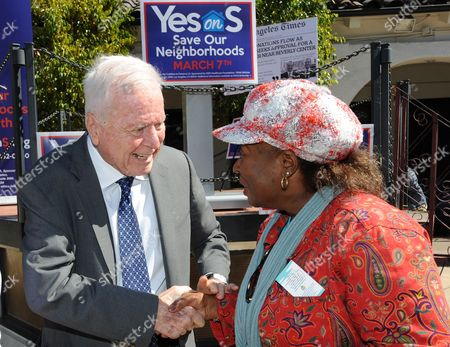 Former Los Angeles Mayor Richard Riordan speaks with Tory Bailey, of the NAACP Beverly Hills-Hollywood branch, after speaking in support of the 'Yes on Measure S' campaign to reign in mega-developments and the 'pay-to-play' culture at Los Angeles City Hall held a press conference and rally at La Placita Olvera in Downtown Los Angeles on