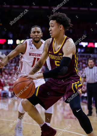 Minnesota's Amir Coffey (5) and Wisconsin's Jordan Hill (11) during the first half of an NCAA college basketball game, in Madison, Wis