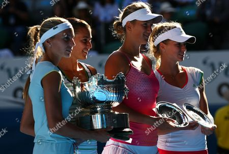 Stock Image of Gisela Dulko of Argentina and Flavia Pannetta of Italy Celebrate with the Trophy Following Their Win Over Maria Kirilenko of Russia and Victoria Azarenka of Belarus at the Australian Open Melbourne 2011 Australia Melbourne