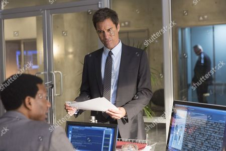 Stock Photo of Arnold Pinnock, Eric McCormack