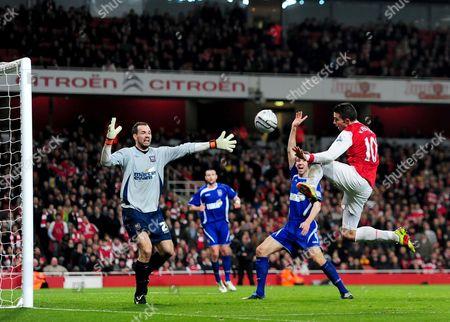 Goalkeeper Marton Fulop of Ipswich Town Blocks Robin Van Persie of Arsenal's Shot United Kingdom London