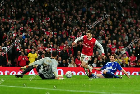 Jack Wilshere of Arsenal Takes On Gareth Mcaudley and Goalkeeper Marton Fulop of Ipswich Town United Kingdom London