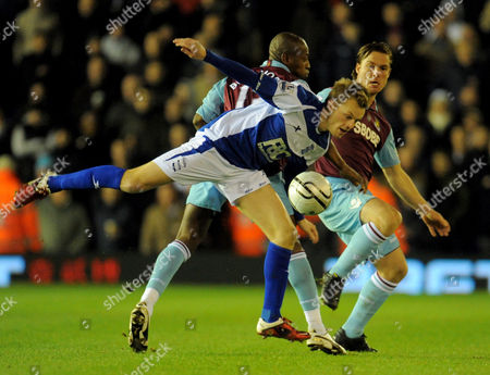 Seb Larsson of Birmingham City and Scott Parker and Luis Boa Morte of West Ham United United Kingdom Birmingham