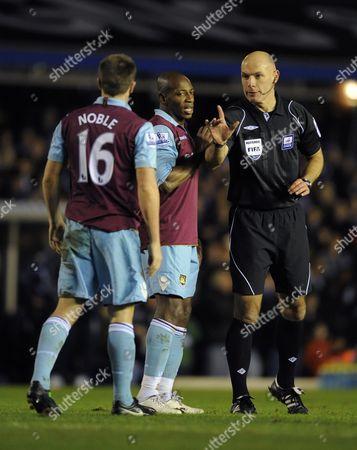 Referee Howard Webb Mbe Points the Finger at Luis Boa Morte and Mark Noble of West Ham United United Kingdom Birmingham