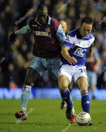 Carlton Cole of West Ham United and Martin Jiranek of Birmingham City United Kingdom Birmingham