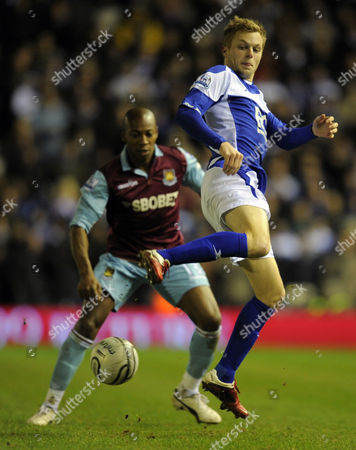 Sebastian Larsson of Birmingham City Flicks the Ball On in Front of Luis Boa Morte of West Ham United United Kingdom Birmingham