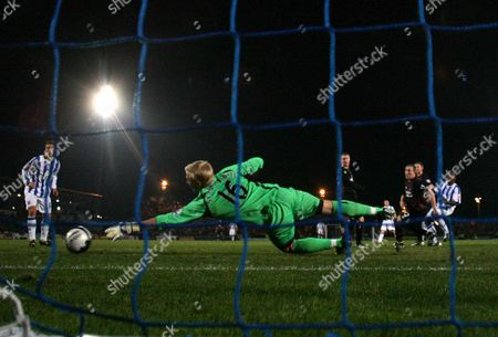Manchester City Goalkeeper Kasper Schmeichel Dives But Fails to Save the Second Goal From Joe Anyinsah of Brighton and Hove Albion (r) United Kingdom Brighton