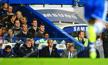 The Son of Jose Mourinho Jose Mario Jr Looks On Top Left Behind the Manchester City Bench Gb London