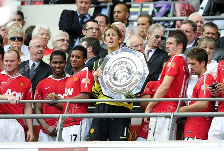 Edwin Van Der Saar of Manchester United Holding the Charity Shield United Kingdom London