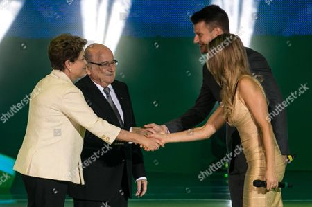 (l-r) Brazilian President Dilma Rousseff Fifa President Sepp Blatter and Ceremony Hosts Rodrigo Hilbert and Fernanda Lima Shake Hands During the Draw For the 2014 Fifa World Cup Brazil in Costa Do Sauipe Brazil File Photo Dated 6/12/2013 Uk Sales Onl