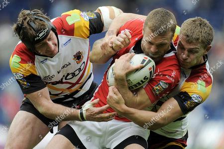 Steve Menzies and Elliott Whitehead of Bradford Bulls Tackles Nick Youngquest of Crusaders Rugby League United Kingdom Edinburgh